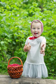 Girl with a basket of raspberries — Stock Photo