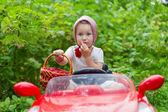 Girl on car — Stock Photo