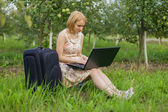 Girl with laptop on the nature — Stock Photo