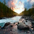 Sunset and mountain river — Stockfoto