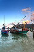 Wooden fishing boats, water, sunset — Stock Photo