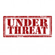 Stock Vector: Under Threat-stamp
