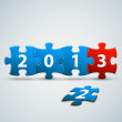 New Year 2013 card made from blue and red puzzle pieces — Stock Vector #12598870
