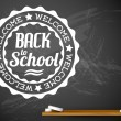 Back to school on a chalkboard — Stock Vector #50588661
