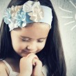 Stock Photo: Portrait of little cute girl who prays or dreams