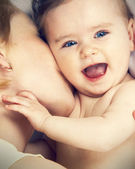 Mother kissed her little baby, close-up — Stock Photo