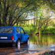 SUV in water — Stock Photo