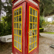 Cool red and yellow phone booth — Stock Photo #19209551