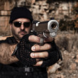 Stock Photo: Mpointing gun to camera