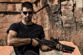 Man with a shotgun — Stock Photo