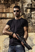 Man with a shotgun — Stock Photo