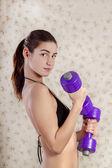 Beautiful girl in bikini with fitness weights — Stock Photo
