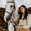 Classical girl with a white horse — 图库照片