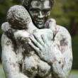 Stock Photo: Statue of womholding child