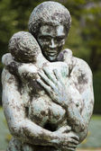 Statue of woman holding child — Stock Photo