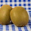 Two kiwis on the table - Stock Photo