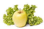 Yellow apple with lettuce on white — Stock Photo