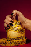 Pear with measuring tape — Stock Photo