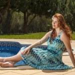 Woman posing next to a swimming pool. — Stock Photo #29293295