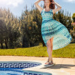 Woman  posing next to a swimming pool. — Stock Photo