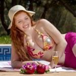 Woman posing next to a swimming pool. — Stock Photo #29294335