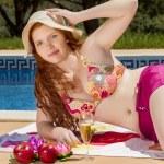 Woman posing next to a swimming pool. — Stock Photo #29294387