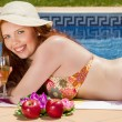 Woman posing next to a swimming pool. — Stock Photo #29294475