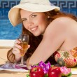 Woman posing next to a swimming pool. — Stock Photo #29294491