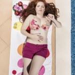 Woman posing next to a swimming pool. — Stock Photo #29294621