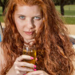 Redhead woman with champagne drink. — Stock Photo