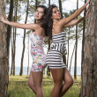 Two young women in tight and short dresses — Stock Photo