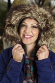 Young beautiful woman with big hairy winter jacket — Stock Photo