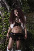 Beautiful young strong hunter warrior woman — Stock Photo