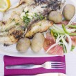 Grilled fish with tomato salad and potatoes — Stock Photo