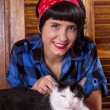 Pin-up girl and cute cat — Stock Photo