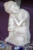 Small white buddha statue — Stock Photo