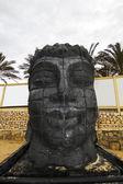 Dark head statue — Stock Photo