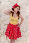 Beautiful pinup redhead girl with skir — Stock Photo