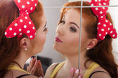 Beautiful redhead girl with colorful pinup clothes — Stock Photo