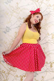 Beautiful pinup redhead girl with skirt — Stock Photo