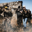 Airsoft group team in daytime action — Stock Photo #50642335