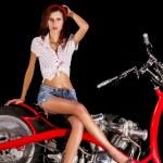 Pinup girl with custom chopper motorbike — Stock Photo #50648777