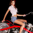 Pinup girl with custom chopper motorbike — Stock Photo #50648885