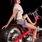 Pinup girl with custom chopper motorbike — Stock Photo #50649735
