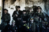 Large Airsoft group team posing in action — Stock Photo