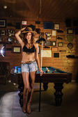Beautiful cowgirl on a snooker club. — Foto Stock
