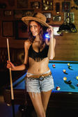 Beautiful cowgirl on a snooker club. — Stock Photo