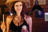 Beautiful cowgirl on a snooker club. — Stockfoto