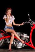 Pinup girl with custom chopper motorbike — Stock Photo