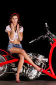 Pinup girl with custom chopper motorbike — Stock Photo
